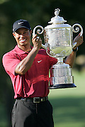 12 August 2007: Tiger Woods celebrates with the Wanamaker Trophy after winning the 89th PGA Championship at Southern Hills Country Club in Tulsa, OK.