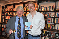 Left to right, STANLEY JOHNSON and his son MAX JOHNSON at a party to celebrate the publication of Stanley Johnson's new book 'Where The Wild Things Were' held at Daunt Books, 83 Marylebone High Street, <br /> London W1 on 18th July 2012.
