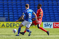 Nottingham Forest's Sammy Ameobi (11) under pressure from Cardiff City's Joe Ralls (8) during the EFL Sky Bet Championship match between Cardiff City and Nottingham Forest at the Cardiff City Stadium, Cardiff, Wales on 2 April 2021.