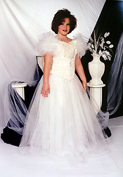 21 May 2015. Laurel, Mississippi.<br /> Collect photos of plus size model Tess Holliday (formerly known as Tess Munster, née Ryann Hoven) in her formative years from a family album. A teenage Tess in white dress. <br /> Photo credit; Tadlock via Varleypix.com
