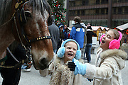 Best friends Elli Rose Focht and Emma Twele enjoy the horses in downtown Chicago while visiting the city on vacation.