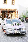 A car decorated for a traditional marriage arriving with the bride. Historic town of Mostar. Federation Bosne i Hercegovine. Bosnia Herzegovina, Europe.