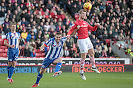 Marley Watkins (Barnsley) gets a header in on target during the EFL Sky Bet Championship match between Barnsley and Wigan Athletic at Oakwell, Barnsley, England on 19 November 2016. Photo by Mark P Doherty.