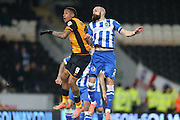 Brighton defender, Bruno Saltor (2) and Hull City striker Abel Hernandez (9) battle in the air during the Sky Bet Championship match between Hull City and Brighton and Hove Albion at the KC Stadium, Kingston upon Hull, England on 16 February 2016.