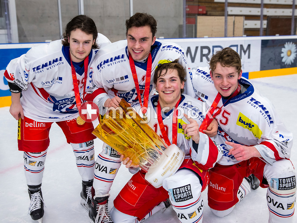 (L-R) Rapperswil-Jona Lakers players Fabricio Giger, Nicolas Germann, Luan Malici and Robin Pfleghar pose for a photo with the Swiss Champion trophy after winning ice hockey game 4 of the Elite B Playoff Final between EHC Chur Capricorns and Rapperswil-Jona Lakers in Chur, Switzerland, Friday, March 16, 2018. (Photo by Patrick B. Kraemer / MAGICPBK)