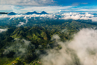 Aerial viw of the Virunga Mountains are a chain of volcanoes in East Africa, along the northern border of Rwanda, the Democratic Republic of the Congo and Uganda. The mountain range is a branch of the Albertine Rift Mountains, which border the western branch of the East African Rift. They are located between Lake Edward and Lake Kivu.