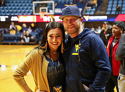 Feb 10, 2018; Morgantown, WV, USA; Country artist Cole Swindell poses for photos with fans after the game at WVU Coliseum. Mandatory Credit: Ben Queen-USA TODAY Sports