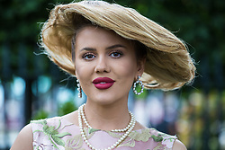 Ascot, UK. 20 June, 2019. A racegoer wears a hat made from hair for Ladies Day at Royal Ascot.