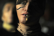 MANHATTAN, NEW YORK, FEBRUARY 15, 2015 A model is seen backstage wearing a lock and metal teeth at the Hood By Air Fashion show at 23 Wall Street in Manhattan, NY. 2/15/2015 Photo by Jennifer S. Altman