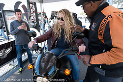 Hannah Arnholt of Miami, FL, learned to change gears at  the HD Riding Academy Jump Start Experience at the Harley-Davidson display located at the Daytona Speedway during Daytona Bike Week. Daytona Beach, FL. USA. Wednesday March 15, 2017. Photography ©2017 Michael Lichter.