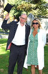 Comedian JENNIFER SAUNDERS and her husband actor ADRIAN EDMONDSON at the wedding of musician Jools Holland to Lady Crystabel Durham held at Cooling Village Church, Cooling, Kent on 30th August 2005.<br />