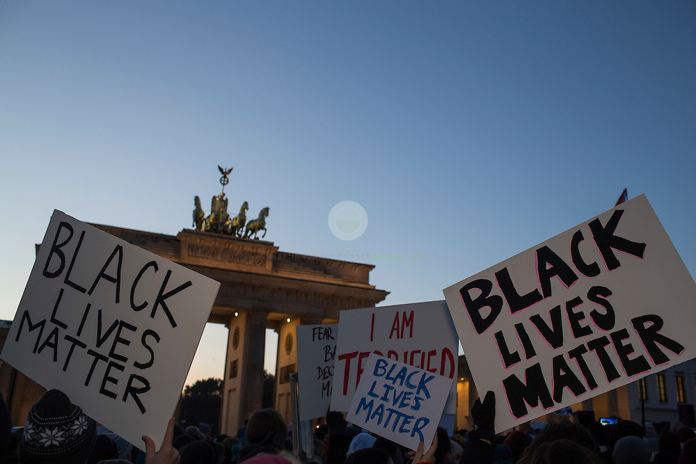 BERLIN, Brandenburg Gate, 12.11.2016 / Hundreds of people, among them many Americans, gathered in the center of the German capital to protest against President-elect Donald Trump.<br /> <br /> About 700 protesters followed a Facebook initiative to rally at the Brandenburg Gate, next to the U.S. Embassy. At this peaceful event, everyone was invited to speak out against Trump and to describe the expectations in the 45th president of the United States. Many spoke about the fear of growing discriminations against minorities.