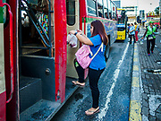 25 SEPTEMBER 2017 - RANGSIT, PATHUM THANI, THAILAND:  Commuters going into Bangkok board a bus at a Rangsit bus stop.      PHOTO BY JACK KURTZ