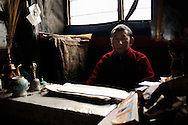 India, Ladakh. Portrait of a praying monk from a little buddhist temple in Phey.