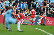 Vincent Kompany of Manchester city is grounded as Alexis Sanchez of Arsenal © celebrates with his teammates after he scores his teams 2nd goal in the 1st period of extra time. The Emirates FA Cup semi-final match, Arsenal v Manchester city at Wembley Stadium in London on Sunday 23rd April 2017.<br /> pic by Andrew Orchard,  Andrew Orchard sports photography.
