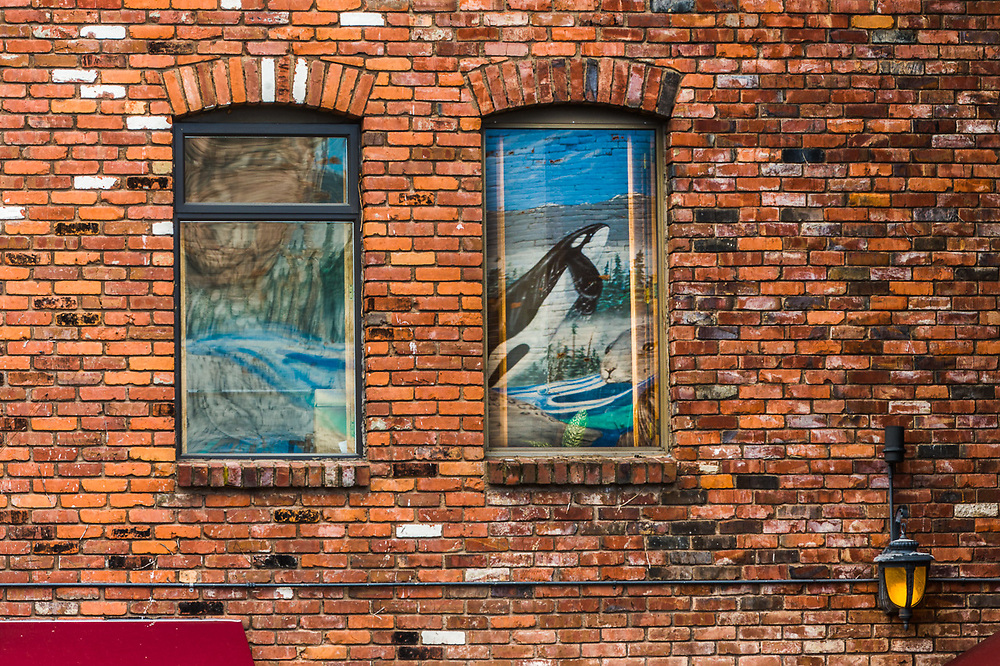 Window reflections of a nearby mural, Victoria, British Columbia, Canada