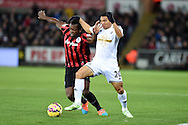 Jefferson Montero of Swansea city holds off Nedum Onuoha of QPR. Barclays Premier league match, Swansea city v Queens Park Rangers at the Liberty stadium in Swansea, South Wales on Tuesday 2nd December 2014<br /> pic by Andrew Orchard, Andrew Orchard sports photography.