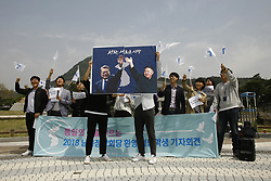 April 26, 2018 - Seoul, South Korea - South Korean people shout slogans during an Inter Korean Summit support rally near the president's blue house in Seoul, South Korea. The Inter Korean summit will be held on April 27, 2018. (Credit Image: © Ryu Seung-Il via ZUMA Wire)