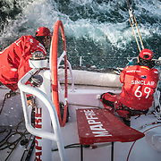 Leg 4, Melbourne to Hong Kong, day 01 on board MAPFRE, Leg start, Louis Sinclair and Guillermo Altadil stacking a sail before a tack. Photo by Ugo Fonolla/Volvo Ocean Race. 02 January, 2018.