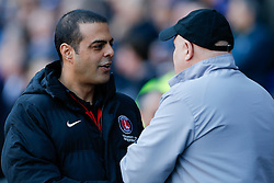 Charlton Athletic Manager Guy Luzon is greeted by Cardiff City Manager Russell Slade - Photo mandatory by-line: Rogan Thomson/JMP - 07966 386802 - 07/03/2015 - SPORT - FOOTBALL - Cardiff, Wales - Cardiff City Stadium - Cardiff City v Charlton Athletic - Sky Bet Championship.