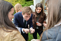 Archie Manners entertains guests at Young Guns raising money for the fight against breast cancer trough Cancer Research UK held at EJ Churchill Shooting School followed by lunch at West Wycombe Park, England. 23 September 2017.