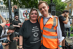 June 17, 2017 - London, UK - London, UK. 17th June, 2017. Paula Peters of DPAC and protest organiser Owen Jones at the Downing St protest calling on Theresa May to resign. Mostly made up of vocal supporters of Jeremy Corbyn, buoyed up by the election results which showed him to be eminently electable, there were speeches by Labour MPs Marsha De Cordova who gained Battersea from the Conservatives, Rupa Huq who greatly increased her tiny majority and Shadow Education Secretary Angela Rayner. There were others who spoke about the DUP, as a party intrinsically linked with Protestant terrorist groups and dominated by a homophobic church which represents a tiny minority of the Northern Irish population, Northern Irish women campaigning for abortion and other women's rights, DPAC who spoke about the Tory assault on the disabled and others. Peter Marshall Images Live (Credit Image: © Peter Marshall/ImagesLive via ZUMA Wire)