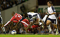 Photo: Daniel Hambury.<br />Tottenham Hotspur v Fulham. The Barclays Premiership.<br />26/09/2005.<br />Tottenham's Ledley Kingt and Fulham's Luis Boa Morte battlew for the ball.