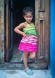 Cuban girl posing at doorway. Havana, Cuba.