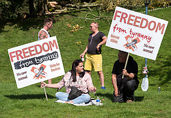 """© Licensed to London News Pictures;30/08/2020; Bristol, UK. A """"Stand Up Bristol"""" protest rally by Stand Up X takes place in Castle Park. The event organisers say it is for truth and freedom. Many are against UK restrictions for coronavirus covid-19 and against lockdown. Some participants are against wearing masks and social distancing, and some either believe conspiracy theories that covid-19 is a hoax or that the virus is man made. Photo credit: Simon Chapman/LNP."""