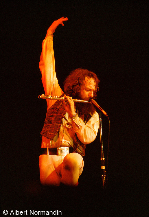 Ian Anderson of Jethro Tull arms up playing flute