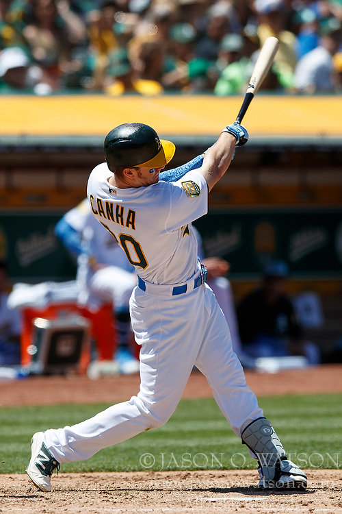 OAKLAND, CA - JUNE 17: Mark Canha #20 of the Oakland Athletics at bat against the Los Angeles Angels of Anaheim during the fifth inning at the Oakland Coliseum on June 17, 2018 in Oakland, California. The Oakland Athletics defeated the Los Angeles Angels of Anaheim 6-5 in 11 innings. (Photo by Jason O. Watson/Getty Images) *** Local Caption *** Mark Canha