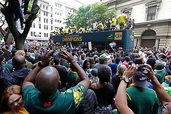 Monday 11th November 2019.<br /> City Hall, Grand Parade,<br /> And City Centre, Cape Town,<br /> Western Cape,<br /> South Africa.<br /> <br /> SPRINGBOKS CELEBRATE WINNING THE RUGBY WORLD CUP CHAMPIONSHIP IN 2019 WITH A COUNTRYWIDE VICTORY TOUR!<br /> <br /> SPRINGBOKS RUGBY WORLD CUP VICTORY TOUR CAPE TOWN!<br /> <br /> Excited fans take photos and selfies as they celebrate the Springboks driving past in their open top bus in the Cape Town City Centre.<br /> <br /> The reigning Rugby World Cup Champions namely the South African Springbok Rugby Team, celebrates winning the Webb Ellis Cup during the International Rugby Football Board Rugby World Cup Championship held in Japan in 2019 with their Victory Tour that culminated in the final city tour taking place in Cape Town. Thousands of South African fans filled the streets of the city all trying their best to show their support for their beloved Springboks and to celebrate them winning the Rugby World Cup for the third time. South Africa previously won the Rugby World Cup in 1995, 2007 and now again in 2019. South African Springbok Captan Siya Kolisi took the opportunity to speak to the gathered crowd about how something like this brings unity and that we should live together as a nation that practices what is known as ubuntu. Ubuntu is a quality that includes the essential human virtues of compassion and humanity. This image taken in Cape Town on Monday 11th November 2019.<br /> <br /> This image is the property of Seven Bang Media Group (Pty) Ltd, hereinafter referred to as SBM.<br /> <br /> Picture By: SBM / Mark Wessels. (11/11/2019).<br /> +27 (0)61 547 2729<br /> mark@sevenbang.com<br /> www.sevnbang.com<br /> <br /> Copyright © SBM. All Rights Reserved.