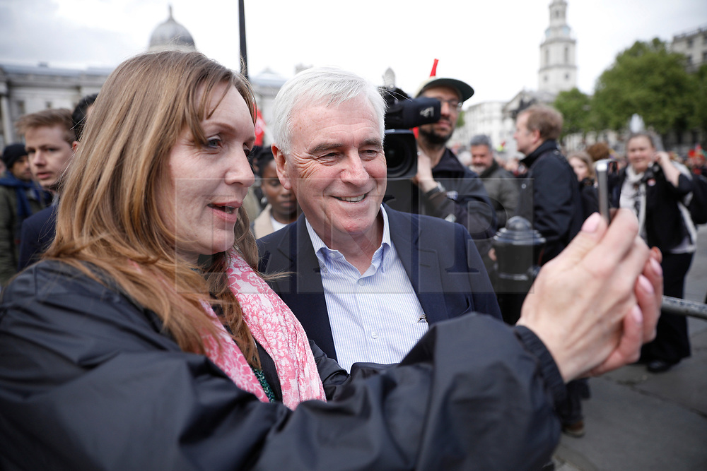 © Licensed to London News Pictures.01/05/2017.London, UK. Shadow chancellor JOHN MCDONNELL poses for a photograph during a May Day protest march at Trafalgar Square in London on May 1, 2017.Photo credit: Tom Nicholson/LNP