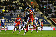 Rory Donnelly scores during the Sky Bet League 1 match between Wigan Athletic and Gillingham at the DW Stadium, Wigan, England on 7 January 2016. Photo by Pete Burns.