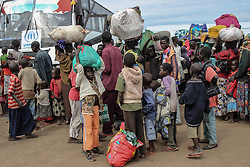 The average number of people crossing into Uganda from South Sudan is around 3,000 people. They have travelled by foot for days with the few belongings they could salvage. More than 300,000 South Sudanese refugees have fled from the country's civil war into Uganda since fighting broke out in July. They mostly travel by foot for days through the bush as roads have been blocked or are too dangerous to cross. The massive influx of refugees has caused a strain in humanitarian aid due to large numbers and lack of funding. BidiBidi settlement is now the third largest in the world and holds more than 210,000 people since its opening in September.