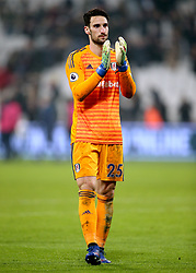 Fulham goalkeeper Sergio Rico applauds the fans at the end of the Premier League match at London Stadium.