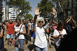 August 18, 2017 - unknown - Barcelona, Spain, August 18, 2017 : Barcelona citizens walking down the Rambla after the minute of silence held at Plaza Catalonia on the day after a terrorist white van running over tourist pedestrians walking down the Rambla on August 17, 2017 around 05:00pm. Photo credit : Marc Javierre-Kohan / Aurimages (Credit Image: © Marc Javierre Kohan/Aurimages via ZUMA Press)