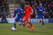 AFC Wimbledon midfielder Dylan Connolly (16) battles for possession with Millwall defender Ryan Leonard (28) during the The FA Cup 5th round match between AFC Wimbledon and Millwall at the Cherry Red Records Stadium, Kingston, England on 16 February 2019.