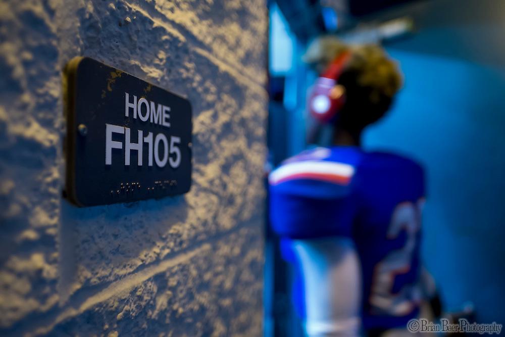 Folsom High School Bulldogs Ju'vae Randolph (27), enters the locker room before the game as the Folsom High School Bulldogs varsity football team host the Oak Ridge High School Trojans,  Friday Nov 4, 2016.<br /> photo by Brian Baer