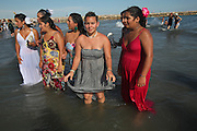 The Doerr family, Manouche, bathe in the holy waters after the procession of Saint Sara during the Gypsy Pilgrimmage of Saintes Maries de la Mer<br /><br />Europe, France, Camargue, Saintes Maries de la Mer, Gypsy Pilgrimmage 'Pelerinage des Gitans aux Saintes Maries de la Mer'. Gypsies from all over the world come to celebrate their patron Saint Sara who is carried by them from the church to the sea-shore. May 24th and 25th every year