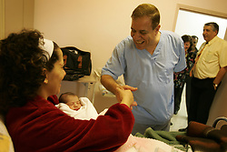 The mother of newborn Mary Kheir, is congratulated by a doctor at Al-Dibs Maternity Hospital in Bethlehem, Palestinian Territories, Nov. 14, 2004. The baby, born into a Christian family, is the first for the Kheir family.
