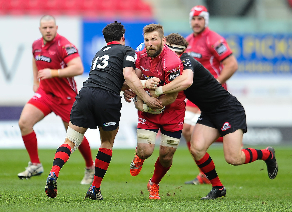 Scarlets' John Barclay is tackled by  Edinburgh's Phil Burleigh and Hamish Watson<br /> <br /> Photographer Craig Thomas/CameraSport<br /> <br /> Rugby Union - Guinness PRO12 - Scarlets v Edinburgh - Saturday 28th March 2015 - Parc y Scarlets - Llanelli<br /> <br /> © CameraSport - 43 Linden Ave. Countesthorpe. Leicester. England. LE8 5PG - Tel: +44 (0) 116 277 4147 - admin@camerasport.com - www.camerasport.com