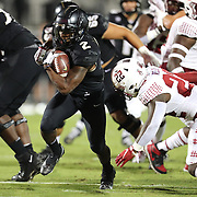ORLANDO, FL - NOVEMBER 14:  Otis Anderson #2 of the Central Florida Knights runs for a touchdown against Kobe Wilson #22 of the Temple Owls at Bounce House-FBC Mortgage Field on November 14, 2020 in Orlando, Florida. (Photo by Alex Menendez/Getty Images) *** Local Caption *** Otis Anderson; Kobe Wilson