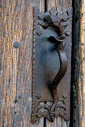 North America, United States, Arizona, Tucson, Mission San Xavier del Bac, founded 1700,  Wrought-iron snake handle on old door.