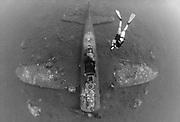 Wreck of a Mitsubishi Zero fighter plane with diver