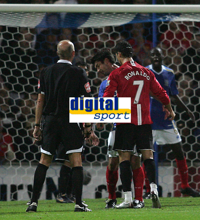 Photo: Lee Earle.<br /> Portsmouth v Manchester United. The FA Barclays Premiership. 15/08/2007.United's Cristiano Ronaldo head butts Richard Hughes and is sent off by the ref.