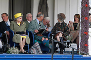 ROYAL FAMILY ATTEND THE BRAEMAR GAMES 2009 IN BRAEMAR , ABERDEENSHIRE .....  DUKE OF EDINBURGH , THE QUEEN , PRINCE CHARLES AND PRINCESS ANNE ENJOY THE GAMES ....  PIC OF MAN WHO APPEARS TO BE ASLEEP BEGIND THE ROYAL PARTY.PIC DEREK IRONSIDE / NEWSLINE SCOTLAND