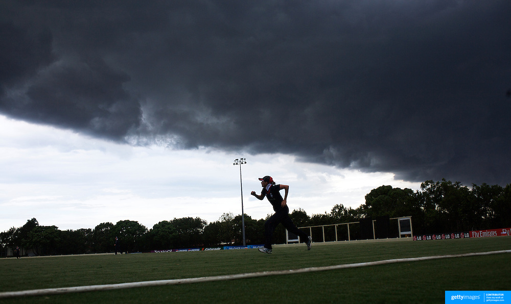 Laura Marsh fielding on the boundary chases the ball during the last over of the match as a storm front moves over Sydney during the match between England and New Zealand in the Super 6 stage of the ICC Women's World Cup Cricket match at Bankstown Oval, Sydney, Australia on March 14 2009, England won the match by 31 runs. Photo Tim Clayton