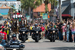 Victory police bikes lead the Budweiser Clydsdale parade down Main Street during Daytona Beach Bike Week 2015. FL, USA. March 14, 2015.  Photography ©2015 Michael Lichter.