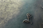 A bicycle laying at the bottom of a shallow canal of Sestri Levante, Italy.<br /> <br /> Sestri Levante, Italy<br /> May, 2012